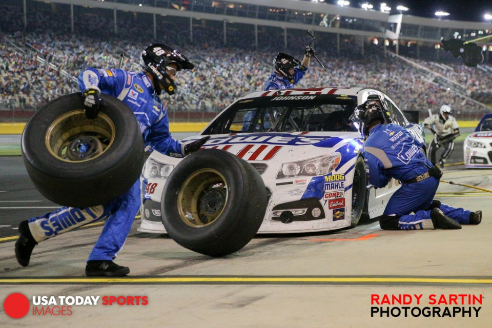 May 16, 2015; Concord, NC, USA; NASCAR Sprint Cup Series driver Jimmie Johnson (48) makes a pit stop during the Sprint All-Star Race at Charlotte Motor Speedway. Mandatory Credit: Randy Sartin-USA TODAY Sports