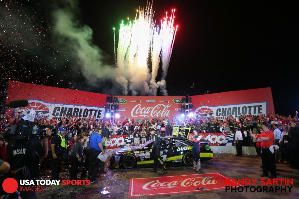 May 24, 2015; Concord, NC, USA; NASCAR Sprint Cup Series driver Carl Edwards (19) celebrates winning the Coca-Cola 600 at Charlotte Motor Speedway. Mandatory Credit: Randy Sartin-USA TODAY Sports