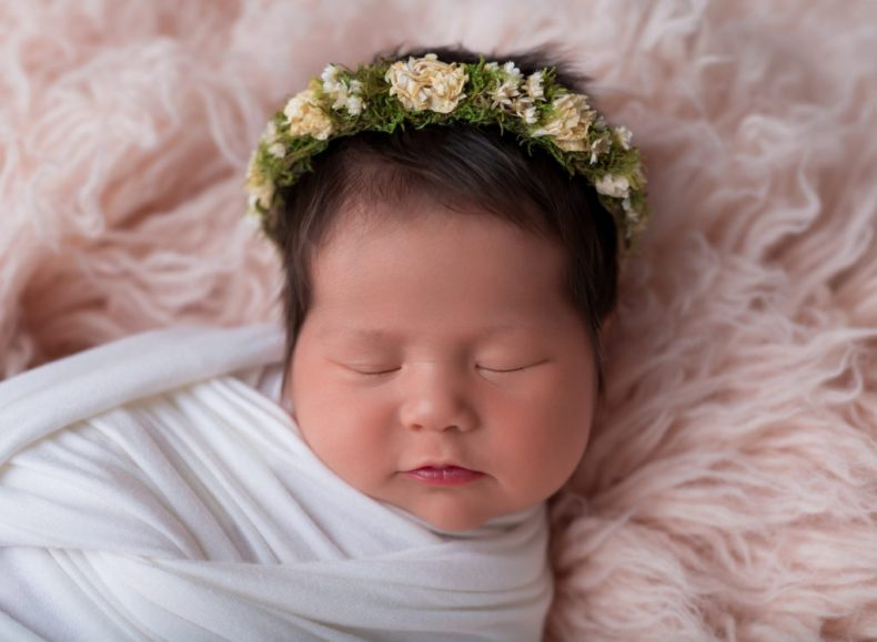 An image of a newborn using virtual photography and archived images.