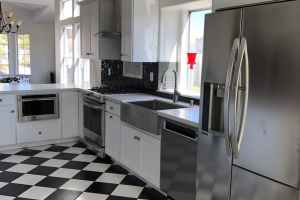 black and white checked floor tile, white shaker cabinets, las vegas kitchen, stainless steel farmhouse sink, mackenzie childs, drawer microwave, quartz countertops, swarovski crystal backsplash, black subway tile backsplash, glam kitchen