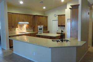 appliance garage, built in double oven, ceraimic tile backsplash, flat panel wood cabinets, gas cooktop, oil rubbed bronze gooseneck faucet, maple stained and glazed cabinets, oil rubbed bronze pulls, quartz countertops, stainless steel 50/50 undermount sink, wood plank porcelain tile,