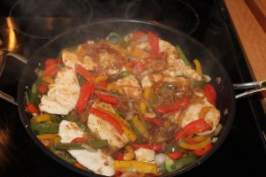 place chicken back into the pan and cover with the peppers