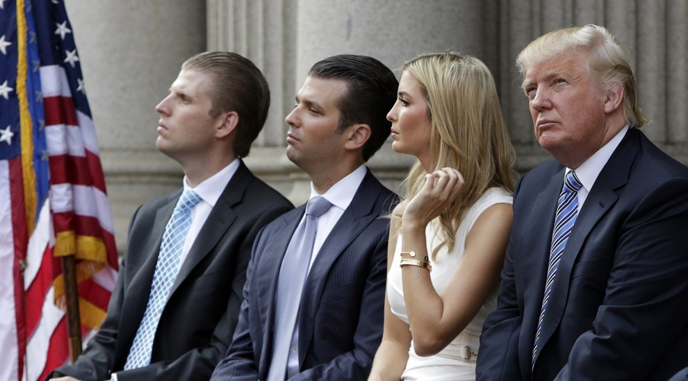 From left: Eric Trump, Donald Trump Jr., Ivanka Trump, and Donald Trump attend the groundbreaking ceremony of the Trump International Hotel at the Old Post Office Building in Washington, D.C., July 23, 2014. <em data-recalc-dims=