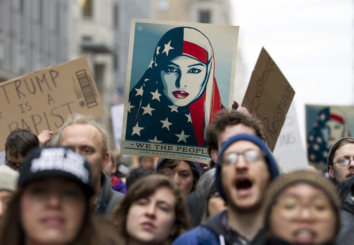 Friday, Jan. 20, 2017 in Washington, ahead of President Donald Trump's inauguration. Protesters pitching diverse causes but united against the incoming president made their mark on Inauguration Day. ( AP Photo/Jose Luis Magana)