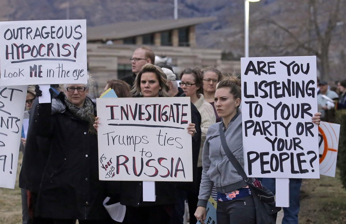 People gather outside the Brighton High School before Rep. Jason Chaffetz's town hall meeting Thursday, Feb. 9, 2017, in Cottonwood Heights, Utah. (AP Photo/Rick Bowmer)