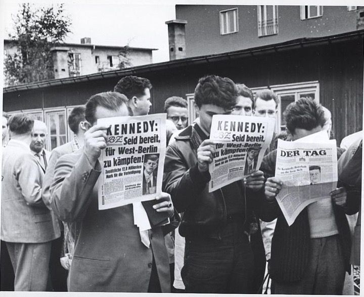 1961: East German refugees read of Kennedy's address regarding the Berlin wall