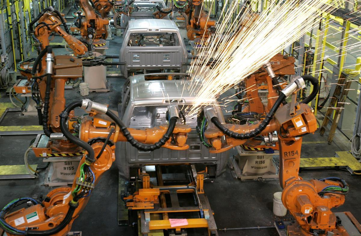 Assembly line robots weld the front cab of Chrysler's 2009 Dodge Ram pickup in Warren, Michigan—Dec. 17, 2008 (AP Photo/Carlos Osorio,file)