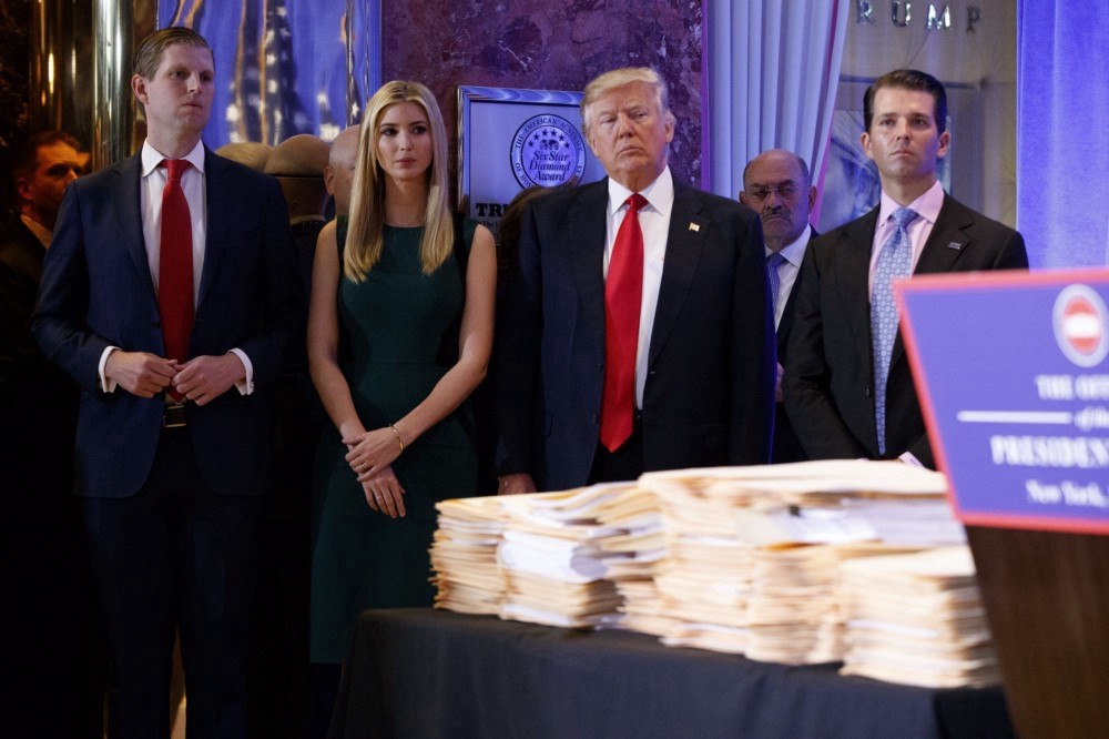 Donald Trump, accompanied by his family, at news conference in the lobby of Trump Tower in New York Wednesday Jan. 11, 2017. (AP Photo/Evan Vucci)