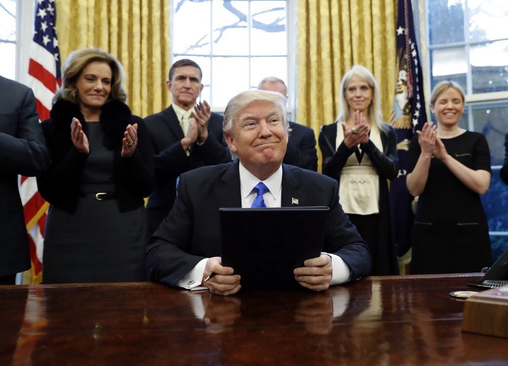 President Donald Trump smiles after signing three executive actions in the Oval Office, Saturday, Jan. 28, 2017 in Washington. (AP Photo/Alex Brandon)