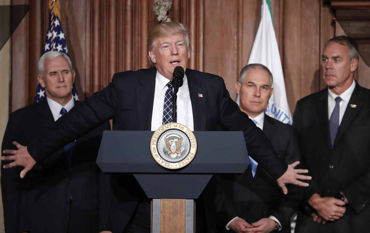 President Donald Trump, accompanied by from left, Vice President Mike Pence, Environmental Protection Agency (EPA) Administrator Scott Pruitt, and Interior Secretary Ryan Zinke, at EPA headquarters in Washington, prior to signing an Energy Independence Executive Order. — March 28, 2017 (AP Photo/Pablo Martinez Monsivais, File)