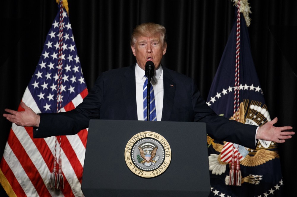 President Donald Trump speaks to the Major County Sheriffs' Association and Major Cities Chiefs Association, Wednesday, Feb. 8, 2017, in Washington. (AP Photo/Evan Vucci)Day 16—Saturday, Feb4