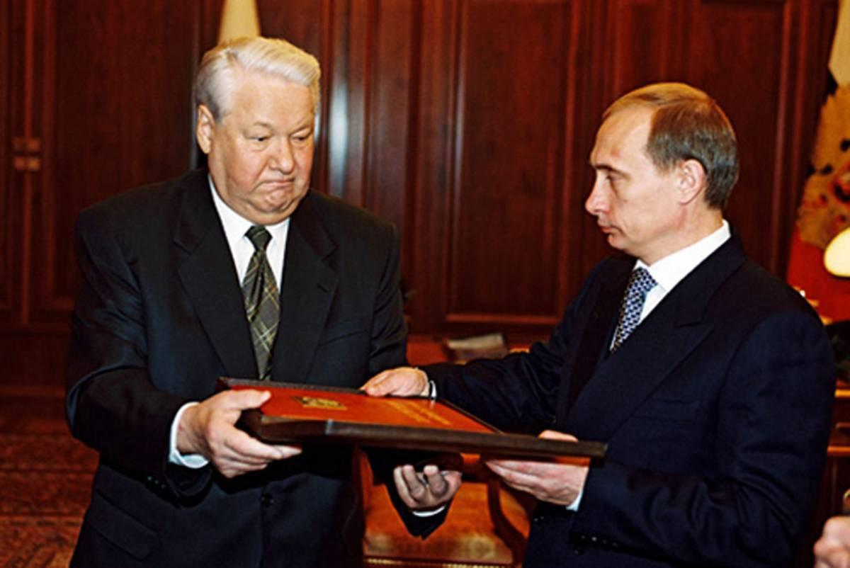 President Boris Yeltsin handing over the presidential copy of the Russian constitution to Vladimir Putin in Moscow, December 31st, 1999