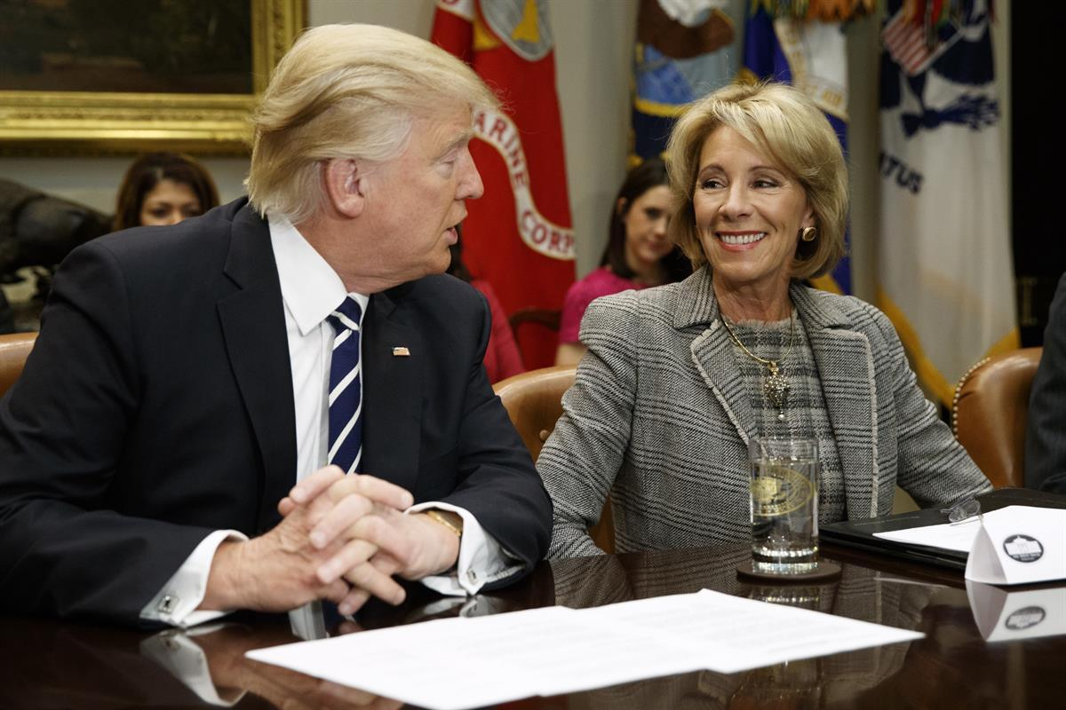 President Donald Trump and Education Secretary Betsy DeVos in the Roosevelt Room of the White House — Tuesday, Feb. 14, 2017 (AP)