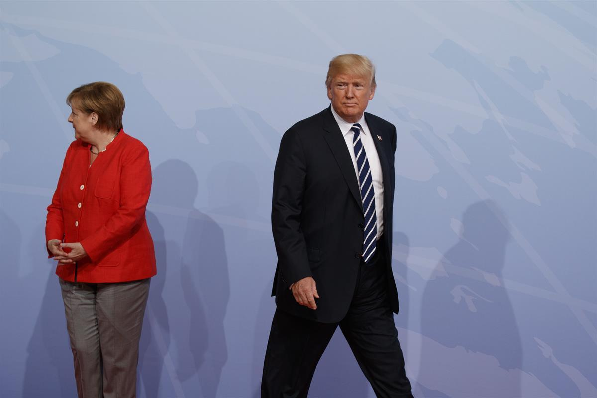 President Donald Trump walks off after being greeted by German Chancellor Angela Merkel after arriving at the G20 Summit, Friday, July 7, 2017, in Hamburg, Germany. — (AP/Evan Vucci)