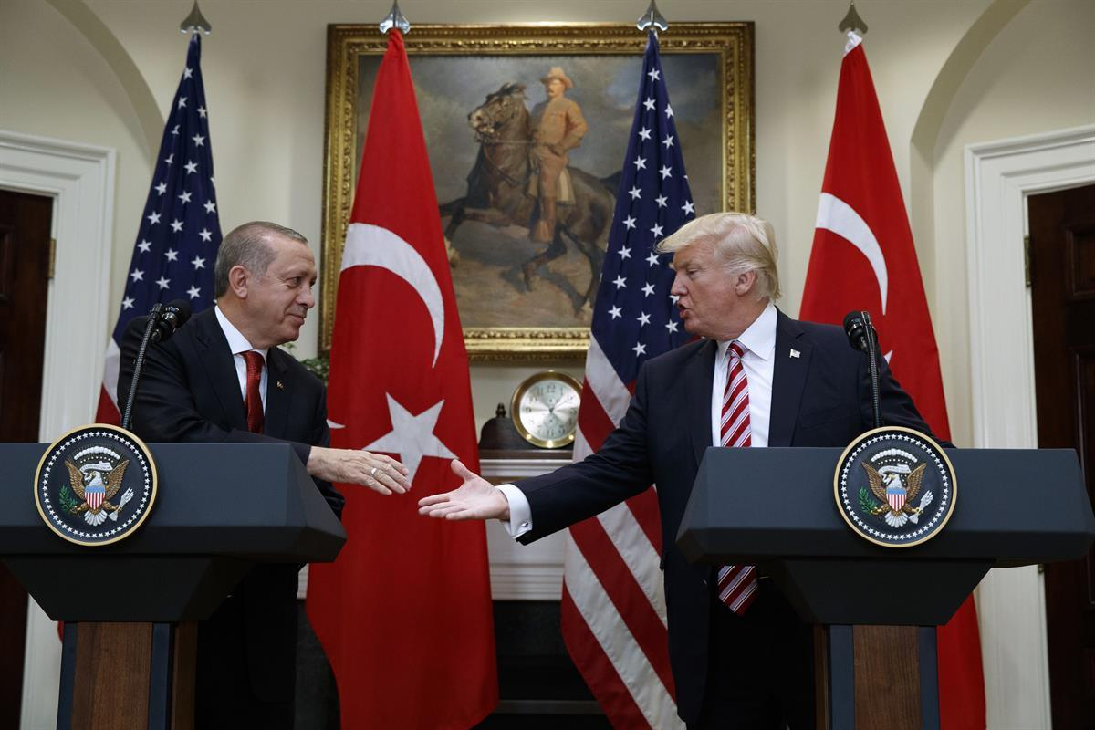 President Donald Trump shakes hands with Turkish President Recep Tayyip Erdogan in the Roosevelt Room of the White House, Tuesday, May 16, 2017, in Washington. (AP Photo/Evan Vucci)