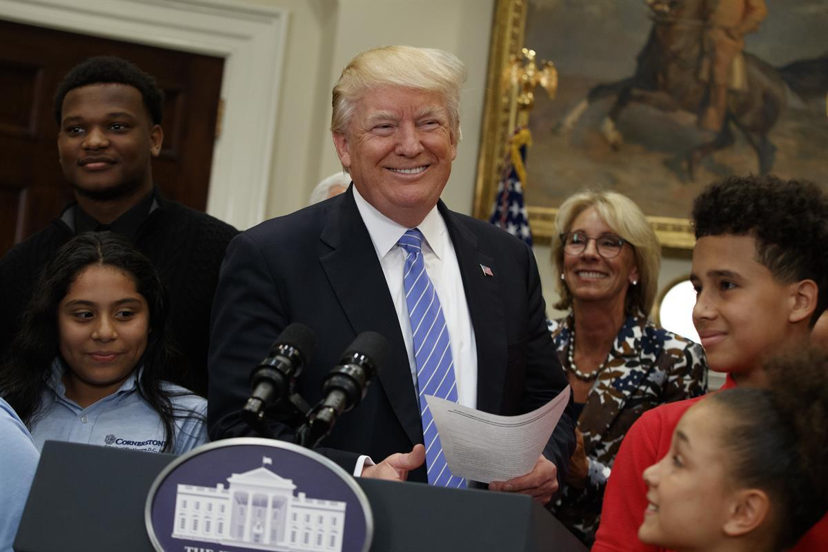 President Donald Trump, accompanied by Education Secretary Betsy DeVos, arrives to speak during a school choice event in the Roosevelt Room of the White House—May 3, 2017. (AP/EvanVucci)