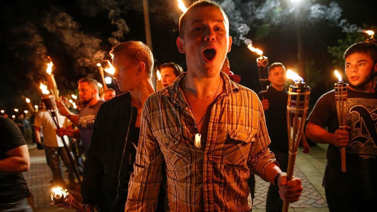 White supremacists march with torches through the UVA campus in Charlottesville, VA- Friday, Aug. 11, 2017 (Mykal McEldowney/The Indianapolis Star viaAP)