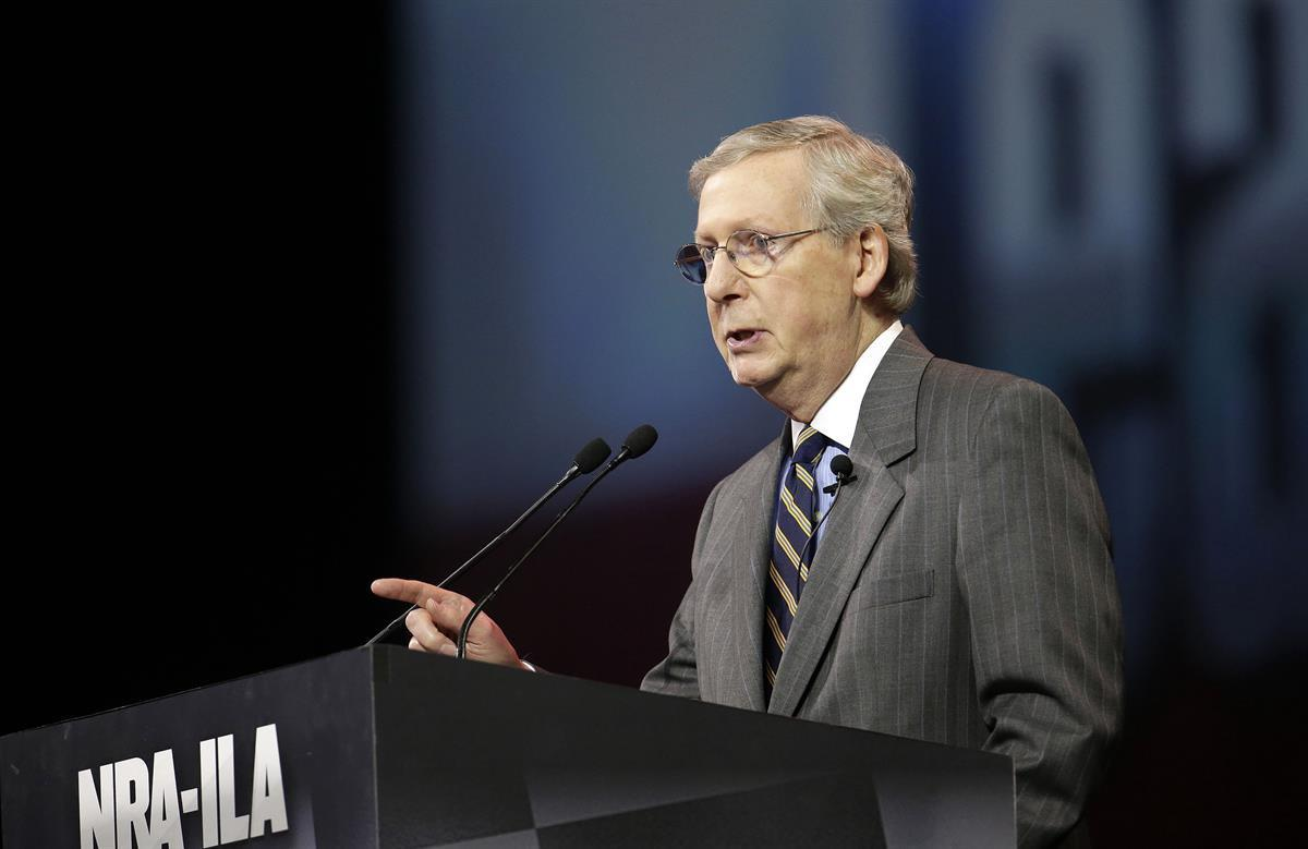 Senate Minority Leader Mitch McConnell, R-Ky., speaks at the leadership forum at the National Rifle Association's annual convention Friday, April 25, 2014 — (AP Photo/AJ Mast)