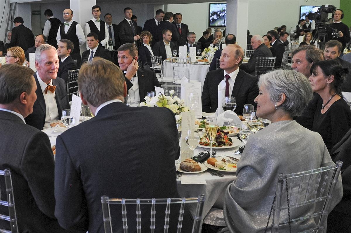 Thursday, Dec. 10, 2015, Russian President Vladimir Putin, center right, with retired U.S. Lt. Gen. Michael T. Flynn, center left. Michael Flynn was in attendance of the 10th anniversary of RT (the Russian government's propaganda network). Flynn <a href=
