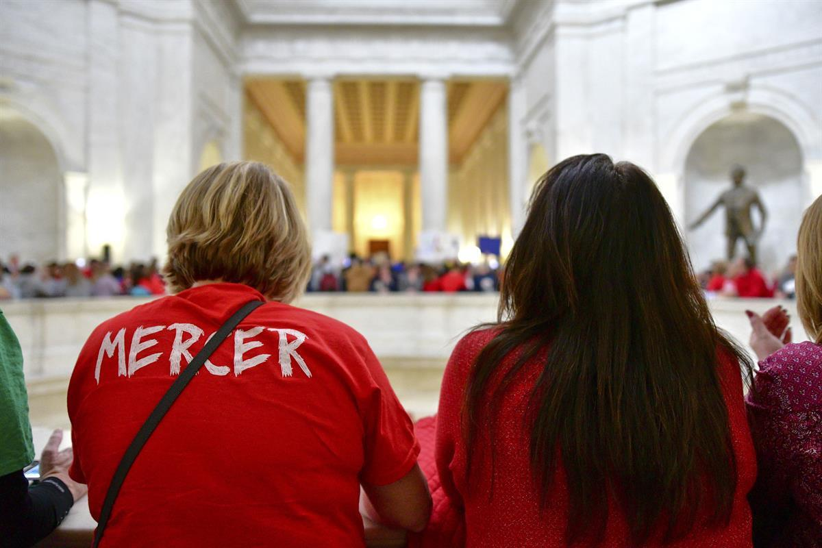 Teachers Emily Hodovan and Misty Meadows overlook the Rotunda in the West Virginia Capitol — Monday, Mar. 5, 2018 (AP)