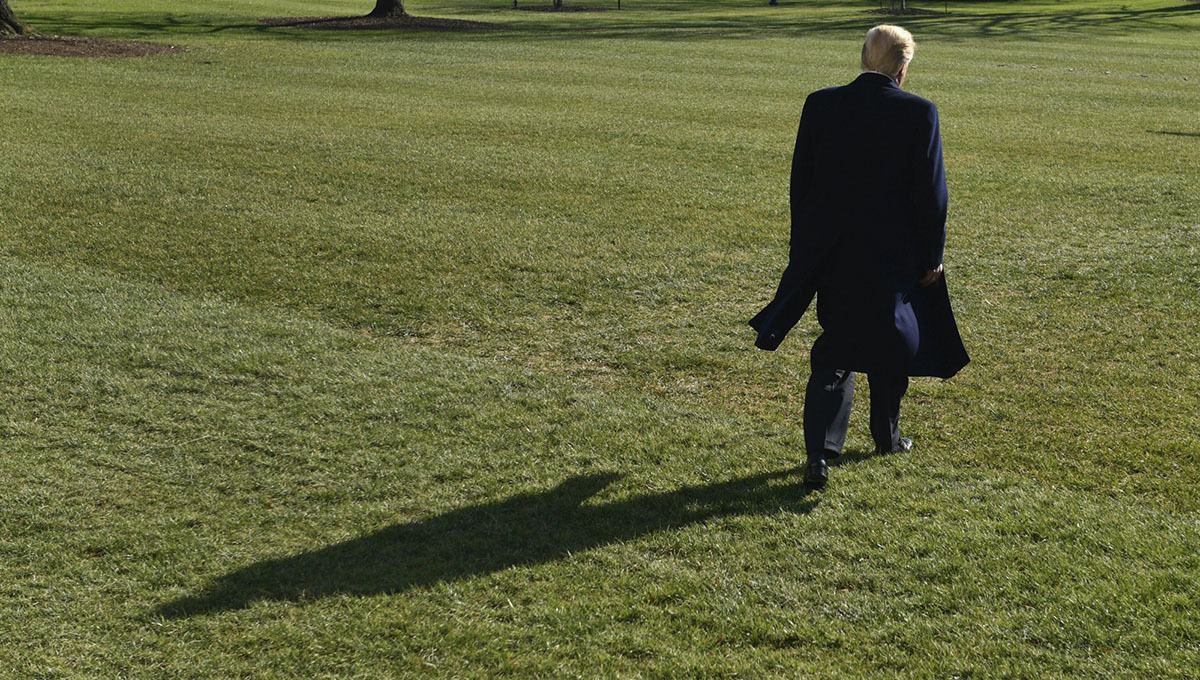 President Donald Trump walks towards Marine One as he departs from the South Lawn of the White House in Washington, Saturday, Dec. 16, 2017, to spend the weekend at Camp David in Maryland. (AP Photo/Susan Walsh)