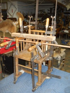 Repairing chairs is very difficult. Chairs are made with frames and streachers that are on angles. making clamping tricky. Also all mortis and dowell joints must be cleaned and wrasped prior to repair to remove the old glue.