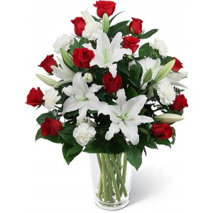 red roses with casa blanca in a vase