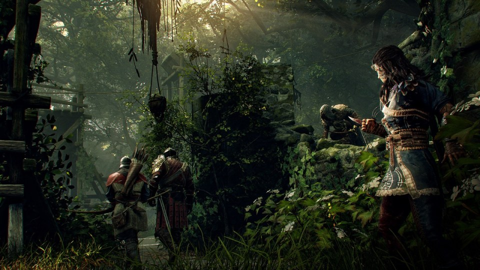 Robin and Marianne hiding in the undergrowth waiting to attack two passing state guards.  Hood: Outlaws & Legends Xbox One Review Rapid Reviews UK
