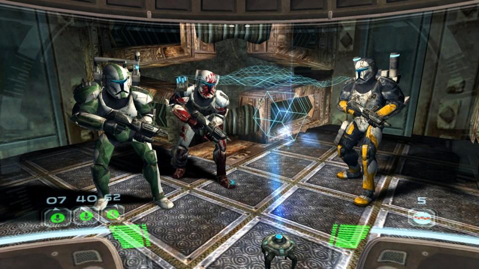 A trio of commandos, crouching with a gun.