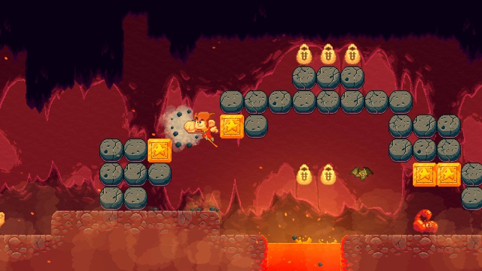 Alex Kidd punching through some stones above a lava filled cavern. Some obstacles can be destroyed in order to carve a safe path
