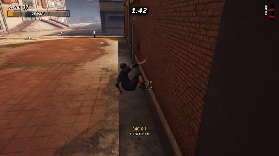Tony hawk doing a FS Wallride off a brick wall