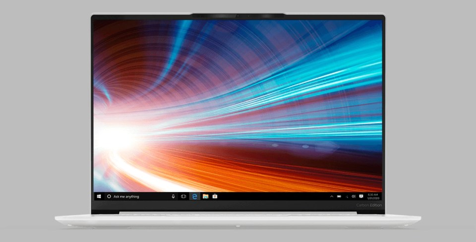 A shot of the Yoga 7i Slim from the very front, focused on its screen, on a grey background.