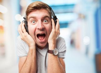 blond man with headphones