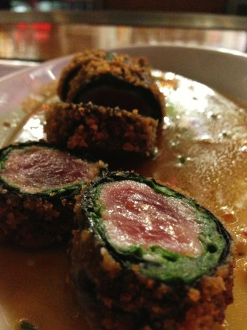 Ahi, arugula and spinach, panko-crusted, flash-fried and served with Sansei's mild soy wasabi butter sauce. Heaven!