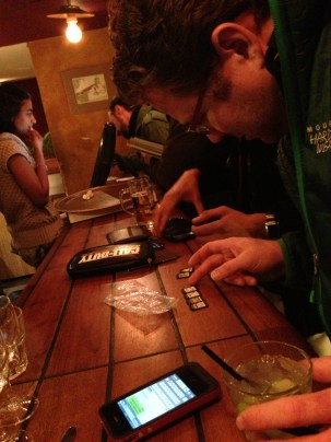 Comparing SIM cards at... whatever bar we were at. Some things are universal, I guess!
