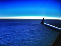 """We departed toward the """"Lower 48"""" into rainy skies and broke out on top, cleared direct to our destination. Nothing to do but watch the sun set in the distance!"""