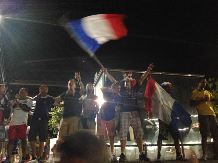 French fans celebrate their victory over Switzerland.  Or maybe it's a scene from Les Mis.  Who knows....