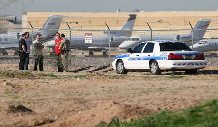 A group of UK plane spotters engaging with local law enforcement in Arizona. This shot was taken at Scottsdale airport, in Phoenix, in February 2008, and was during the weekend that the city hosted the Superbowl. Significant sporting events such as this attract the wealthy and famous, and local airfields are crammed with private jets, parked row upon row. Naturally an attraction for spotters and photographers alike, many enthusiasts will arrange vacation plans to attend this kind of event. In this case the police used the ideal approach - they came along and said hello, they checked out who we are, what we were doing and politely set the boundaries. In this case, we were asked not to go right up to the fence - keep a little distance so as not to alarm the locals or passengers. So the other side of the road where I was stood was perfect for landing shots and watching the action, and provided a situation where every one was happy.