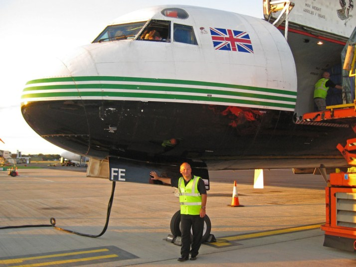 "Matt stands beside a 1961 vintage Lockheed L-188 Electra freighter of Atlantic Airways at Jersey airport in the UK Channel Islands, in August 2011. ""this is the kind of airplane I really miss these days - and one of the few I flew on which was actually older than I am !"" he says ""shortly after this they were sold on to Canada, and until then were the last to be operating outside of North America. I'm not even sure if the two they sold are still flying in Canada now"""