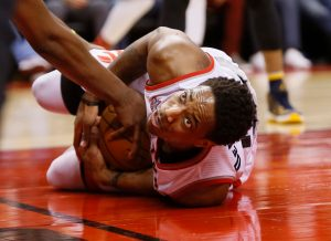 Apr 16, 2016; Toronto, Ontario, CAN; Toronto Raptors guard DeMar DeRozan (10) holds onto the ball after being knocked down against the Indiana Pacers in game one of the first round of the 2016 NBA Playoffs at Air Canada Centre. Indiana defeated Toronto 100-90. Mandatory Credit: John E. Sokolowski-USA TODAY Sports