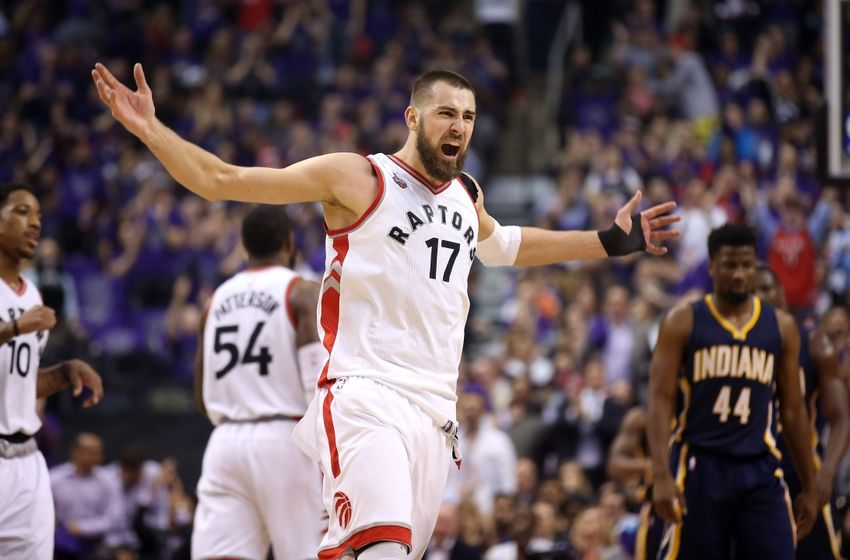 Apr 18, 2016; Toronto, Ontario, CAN; Toronto Raptors center Jonas Valanciunas (17) celebrates after making a basket against the Indiana Pacers in game two of the first round of the 2016 NBA Playoffs at Air Canada Centre. Mandatory Credit: Tom Szczerbowski-USA TODAY Sports