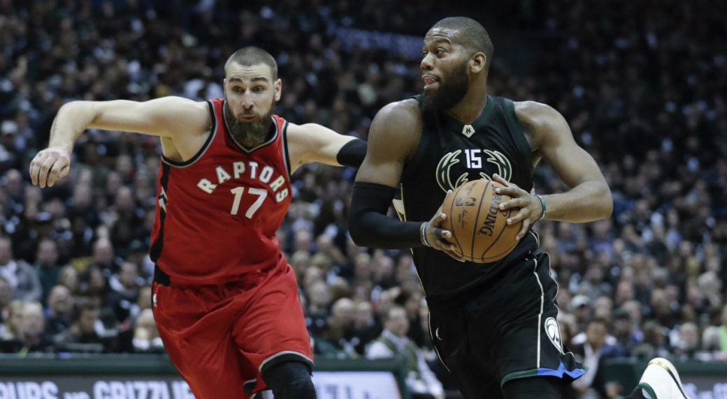 Greg Monroe drives past Jonas Valanciunas