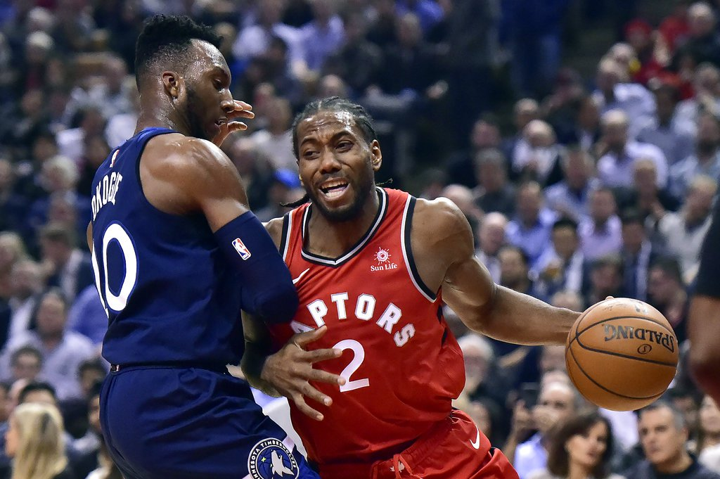 Kawhi Leonard of the Toronto Raptors trying to get around Josh Okogie of the Minnesota Timberwolves