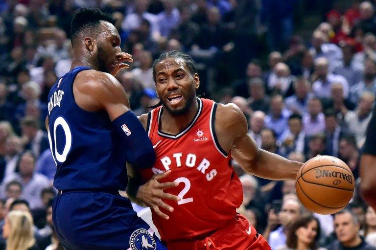 Kawhi Leonard of the Toronto Raptors trying to get around Josh Okogie of the Minnesota Timberwolves