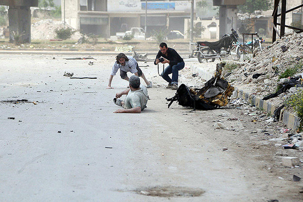 Reporters on Syria's war: why they do it, what they risk