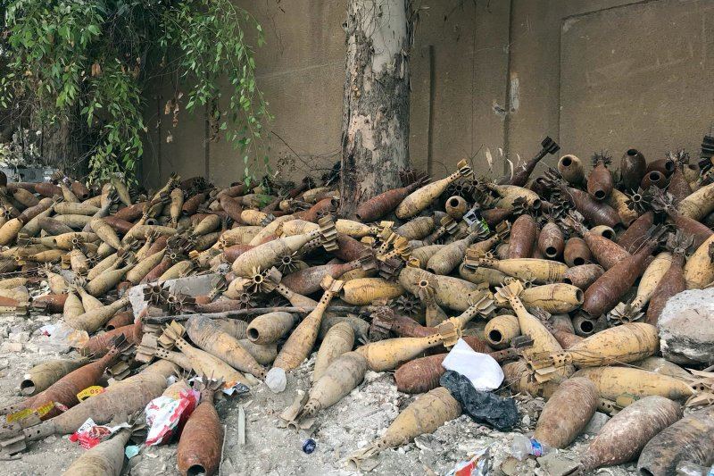 Mortar shells are piled up in the back of a school playground in Raqqa, Syria. Ruth Sherlock/NPR