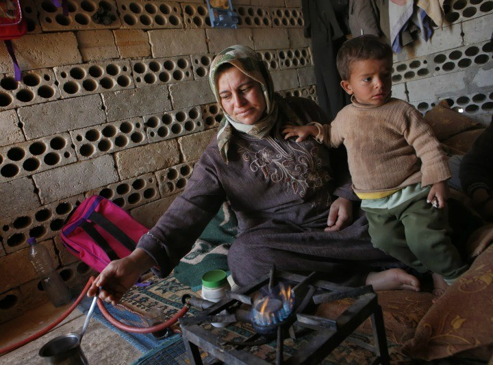 A Syrian refugee with her child. (NB: This is not the woman to whom this story refers.