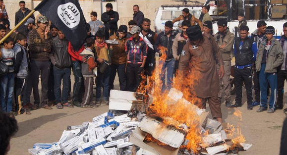ISIS beheads top police official for smoking cigarettes