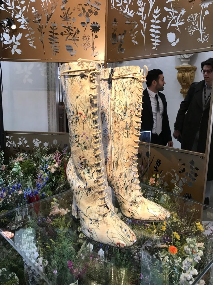 Hand painted Bottega Veneta snakeskin boots, displayed above fresh flowers