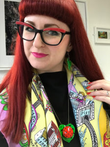 Lori wearing a scarf designed by Grayson Perry for Tate